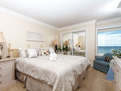 Spacious Master Bedroom - King sized bed and mirrored closet space. Tall end tables and awesome lighting