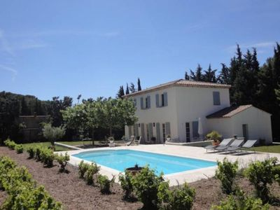 Photo for Beautiful Provencal Bastide contemporary surrounded by vineyards, shaded by plane