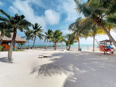 Photo for Caribbean waterfront condo w/ shared pool & dock - walk to the beach