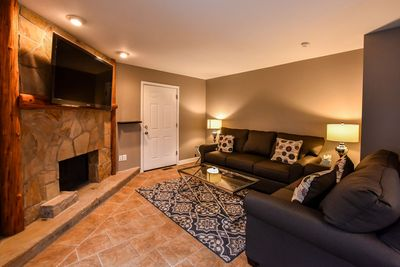 "Living room with "" television and gas fireplace"