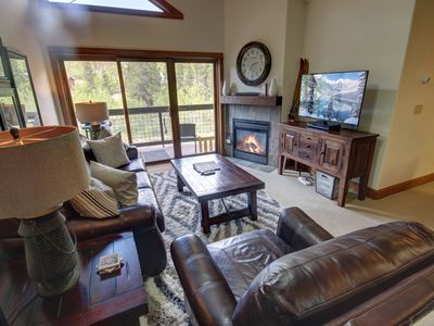 Photo for This two bedroom  sleeps 6 with a lovely forest view! A shared hot tub and pool are located on the main level.