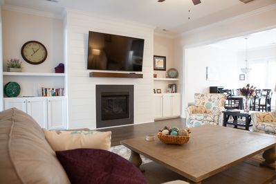 "75"" smart TV and gas fireplace make this a cozy space"