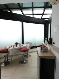 Photo for apartment in villa at 20 m. from the sea with sea view, patio, shared swimming pool