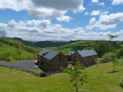 Photo for With magnificent views across the Epynt Mountain range and spectacular Brecon Beacons, this traditio