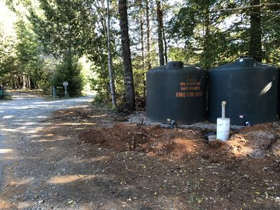 Road to house is left of water tanks