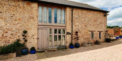 Photo for Beautifully converted milking parlour with amazing views and hot tub