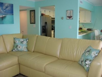 """Living area with comfy leather sofa with full size pull out and  42""""TV"""