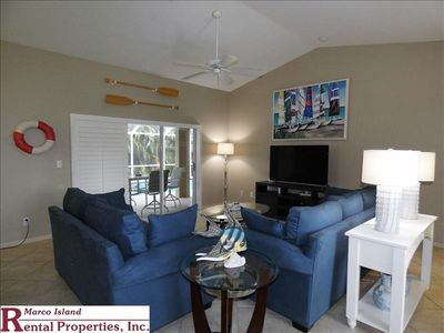 Photo for 900 Seagrape: Steps away from beach entrance; walk to movies,restaurants,shopping!