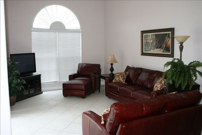 Relax and enjoy the family room overlooking the lanai and canal!