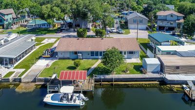 NEW LISTING with a covered dock, boat ramp, and 10 min paddle to Rogers Park