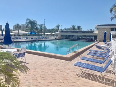 Pool area includes shuffleboard, ping pong, tv sitting area, bathroom/laundry