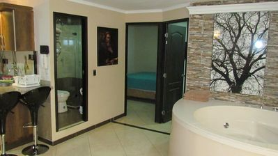 Photo for 2 Bedroom Ground Floor Ac, Hot Tub. 6 Blocks To Lleras. 10 Meg Wifi, 3 TV's.