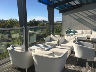 resident lounge with AMAZING roof top views of Centennial Park