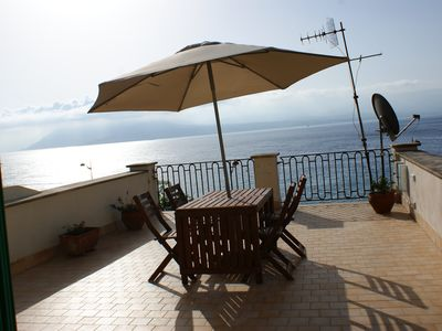 Photo for In front of the Strait of Messina, a charming terrace on the sea, just in front