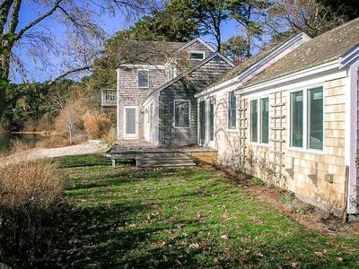 Photo for Bright and airy two story cottage with central A/C and High Speed Internet access on White Pond.