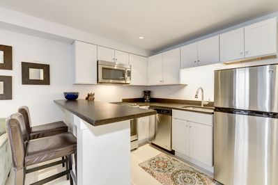 The kitchen has all new appliances, granite counters, and ample prep space.