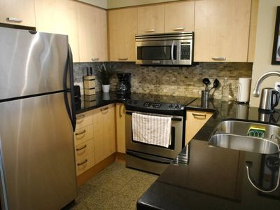 Photo for Amazing New 1BR Condo with Parking!