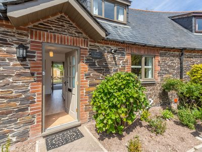 Photo for Wedge Cottage is a delightful holiday home in the Curved Stables at Roserrow.