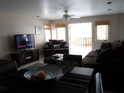 An open living/dining area looking out into the balcony