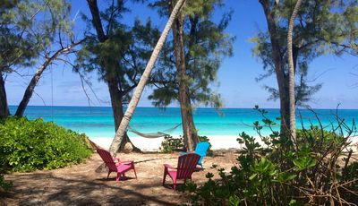 Poponi Beach with hammock and seating.