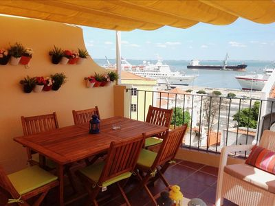Photo for Remedios VI -sunny terrace with river view , fantastic location in historic center