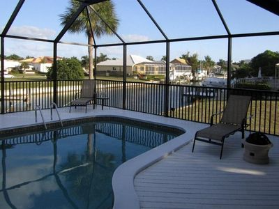 Screened Lanai Overlooking Canal With Gas Fire Pit And Heated Saltwater Pool
