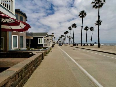 Photo for FANTASTIC DUPLEX ON THE STRAND OF OCEANSIDE, STEPS AWAY FROM THE BEACH