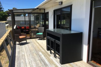 The deck and conservatory