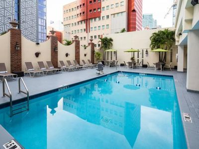 Photo for Group Getaway! Four Comfy Units for 16 in Downtown! Pool, Steps to Attractions!