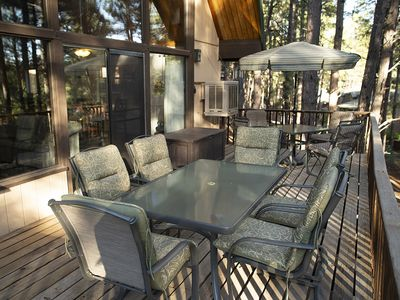 Large deck with ample seating. Eat, drink, read, or just relax and enjoy nature.