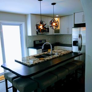 Granite island with live wood edge dining counter.
