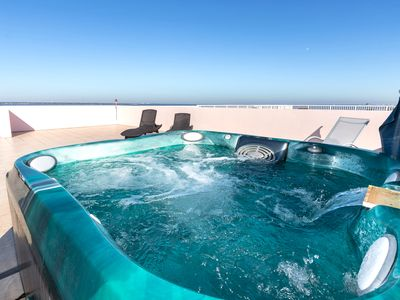 Photo for PENTHOUSE! Private HOT TUB on Roof Top Patio-End Unit-RIGHT on WATER-2 Porches!!