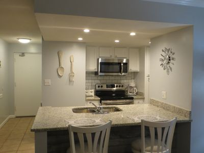 VIEW OF KITCHEN,RECESSED LIGHTING, FLAT TOP STOVE, MICRO WAVE,  GRANITE COUNTER
