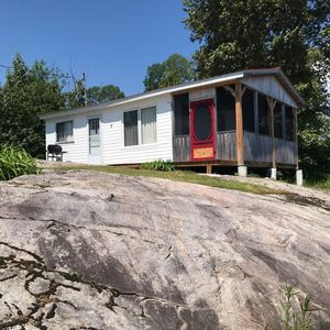 Photo for The Driftwood, Lake front Cottage in with large screened in porch