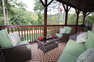 Deck overlooking the lake.  Shaded area perfect for reading and morning coffee