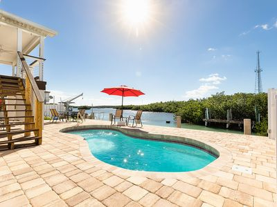 Photo for WATERFRONT, VIEWS, HEATED POOL, 130 ft. OF DOCK, PRIVATE RETREAT