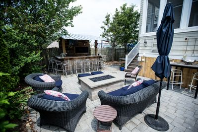 Outside sitting area with gas fire pit and bar