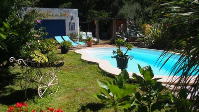 Photo for charming house surrounded by trees with pool
