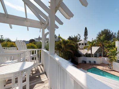 Photo for Sunny condo w/ private patio & shared heated pool - one block to the beach!