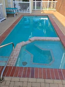 Photo for Ground floor condo 1/2 block to the beach. Sleeps 7, 2 bedrooms, 2 baths. Pet-friendly. Shared Pool