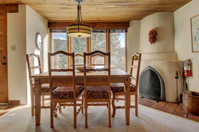 Dining area has kiva fireplace and view of Valdez Valley; seats 6 people