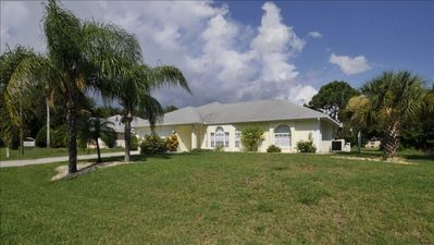 Photo for Beautiful Canal View Home with Large Lanai, Pool, Spa, Bikes