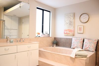 Clean up after a day at the beach in the shower or over-sized bathtub.