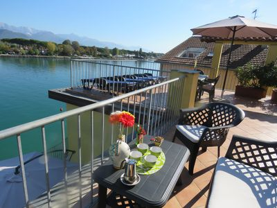 Photo for Green Apartment: Attic, 5 places, terrace on the river and berth
