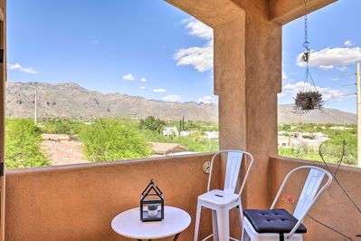 This Tucson condo boasts a balcony with stunning mountain views.