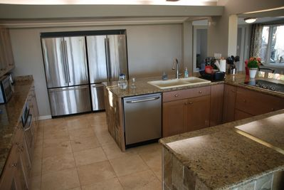 The kitchen is spacious with double refrigerator with freezers.