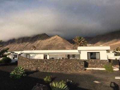 Photo for Bungalow NYTOSIX in Famara for 5 persons with terrace, garden, views to the ocean, views of the volcanoes, WIFI on the go and less than 200m to the sea