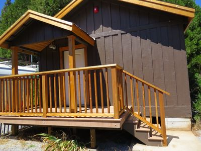 Cabin entrance, adjacent to parking for boats and vehicles.