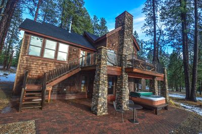 Back side of house with Large Deck, Hot Tub, Bistro Tables, Grill, and Views