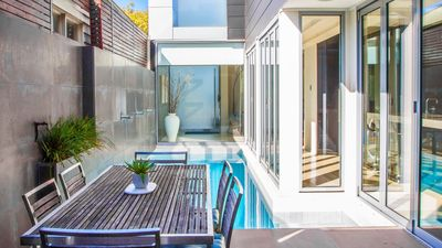 Photo for River's Edge - Ultra-modern family home with heated pool
